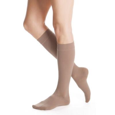 Kompressziós térdharisnya. A kompressziós hatás elősegíti a vénás vér visszaáramlását a szívbe és ennek eredménye a könnyebb láb érzése. Javítja a keringést, megelőzi a lábdagadást, és a visszerek kialakulását. A termék vényköteles, megvásárolható személy